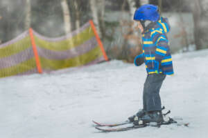 Little boy skiing unassisted for the first time